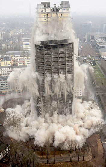 Demolition of a building as a picture of economic collapse