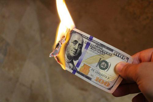 Burning hundred-dollar bill
