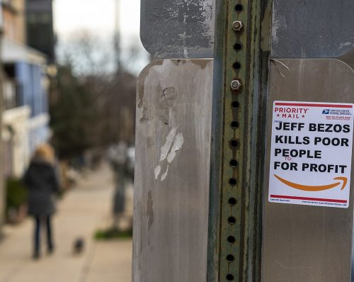 "Sign ""Jeff Bezos Kill Poor People for Profit"" by Mike Maguire, CC BY 2.0 , via Wikimedia Commons"