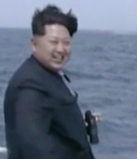 Kim Jong-un watching submarine's test missile launch.