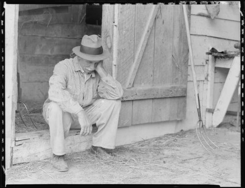 Farmer in despair over Great Depression in 1932.