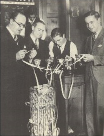 Gathering around the stock ticker during the 1929 US stock market crash.