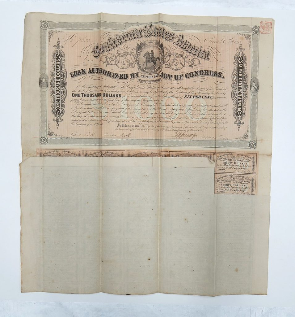Standard issue $1,000 US bond, stating coupon interest as part of the bond yield with some coupons still attached at bottom. ( Auckland Museum [CC BY 4.0 (https://creativecommons.org/licenses/by/4.0)])